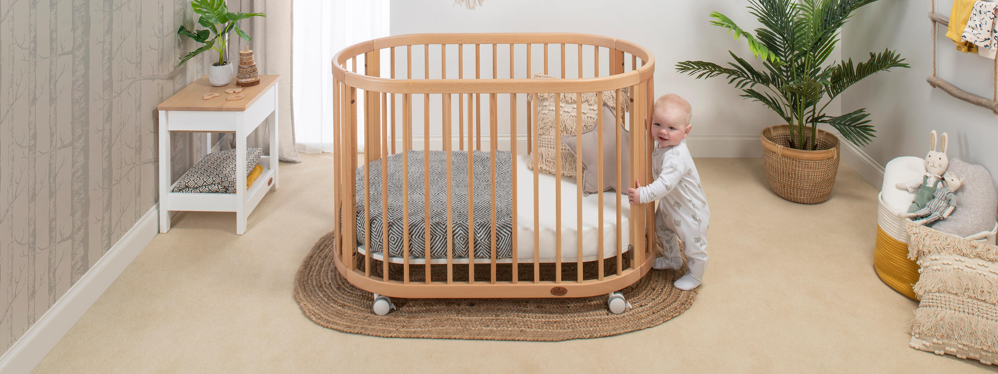 Product_Page_Lifestyles_1600_x_600_Oasis_Oval_Cot_Beech_with_Baby_FORWEB__2x