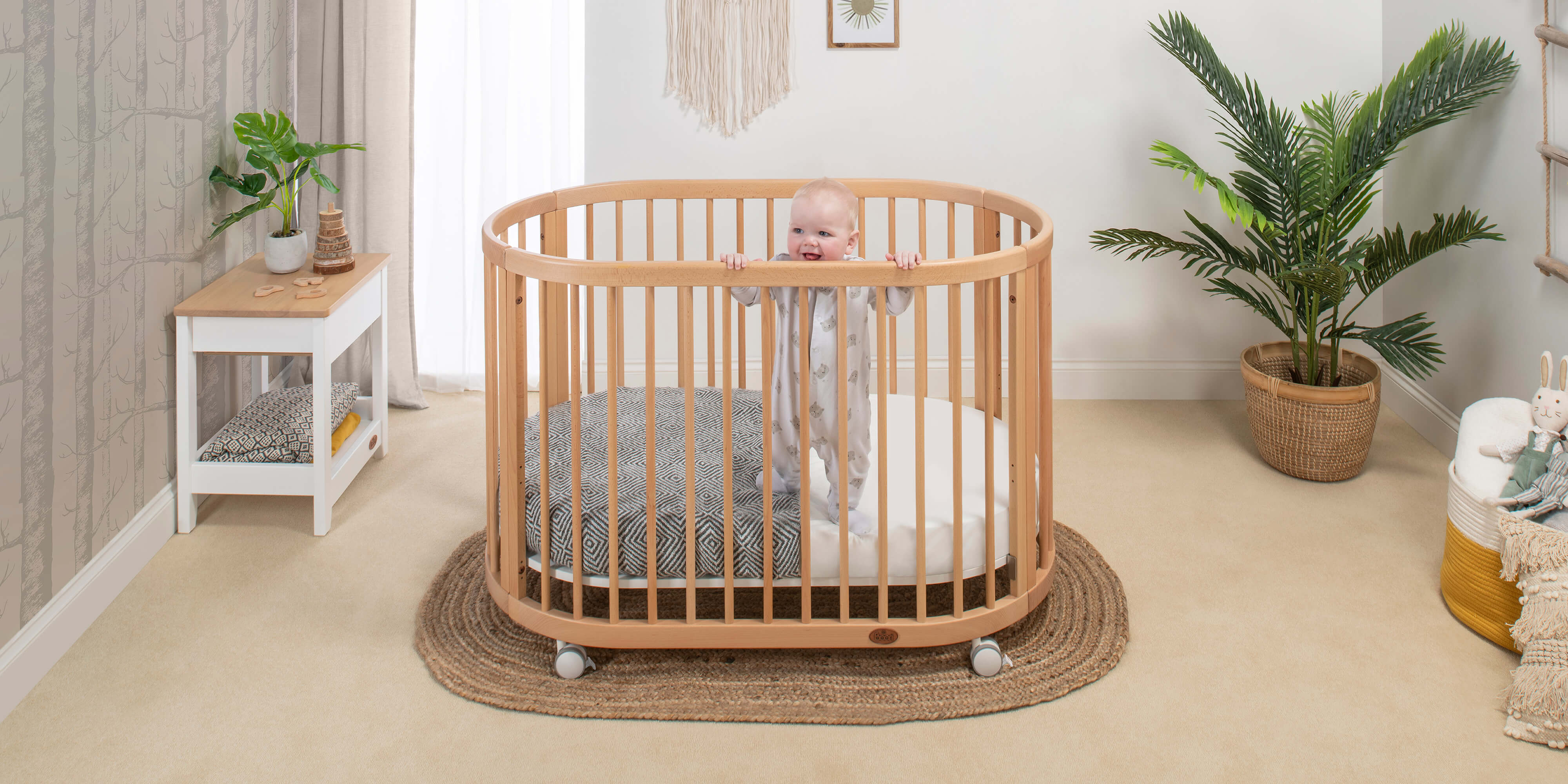 Oasis Oval Cot with Baby Standing