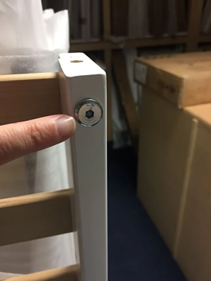 Bolt insert in cot bed side panel